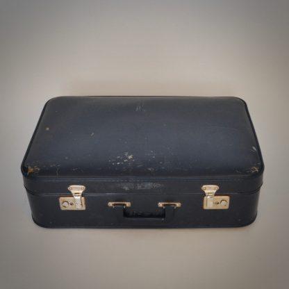 Vintage blauwe koffer met levenservaring