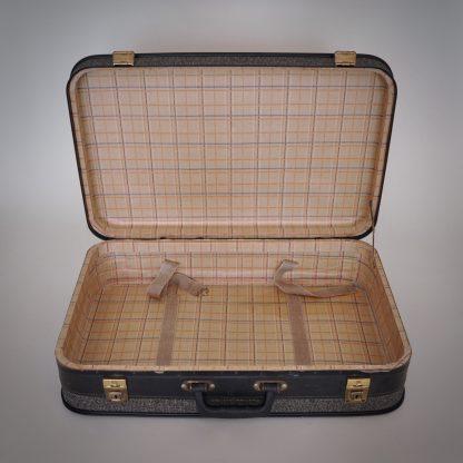 Ouderwets vintage koffer in antraciet